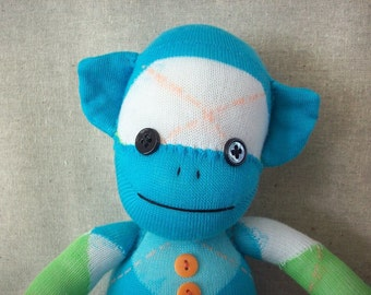 Sock monkey stuffed animal plush in blue and white argyle, monkey made from socks, stuffed toy monkey