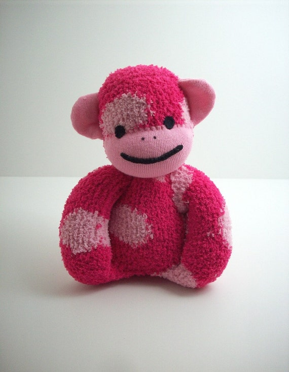 A sock monkey for babies in pink polka dots