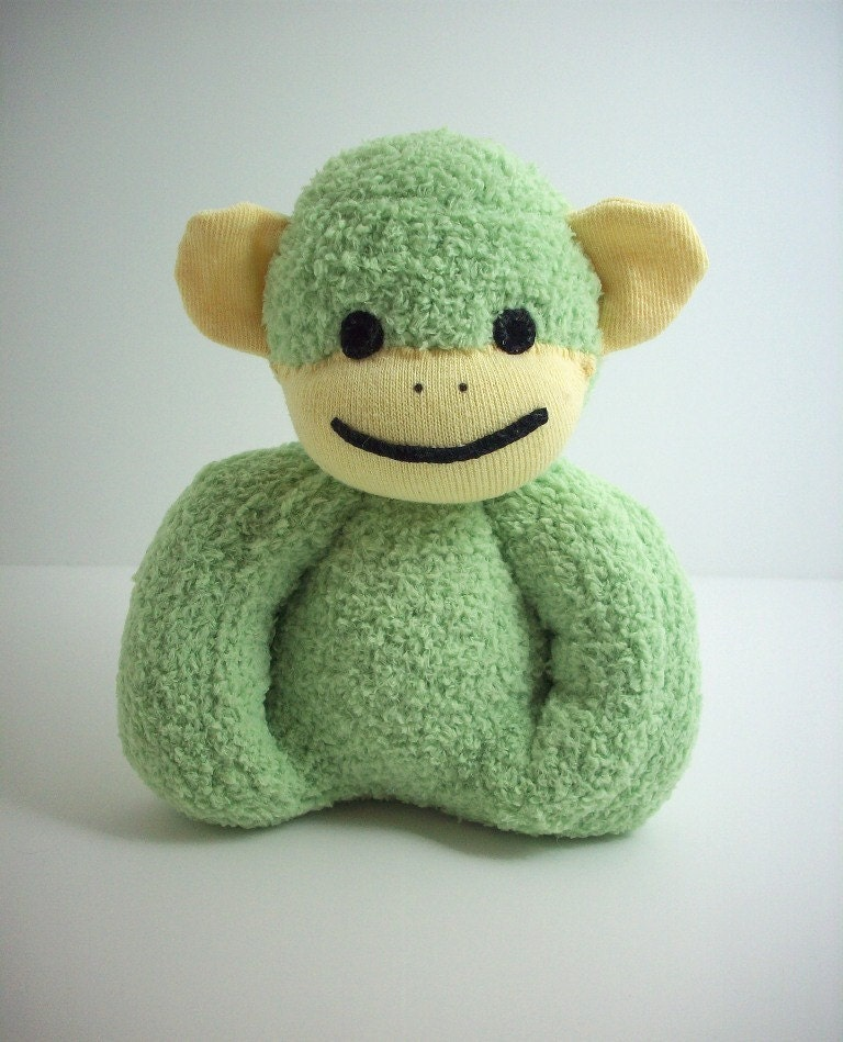 Sock monkey toy for baby in green and yellow