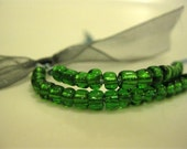 Envy Bracelet - Green glass beads on a Blue Cord