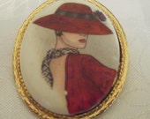 """Vintage """"Flapper"""" or """"red hat lady"""" brooch, Hand-painted , 1950s  porcelain and gilt metal"""