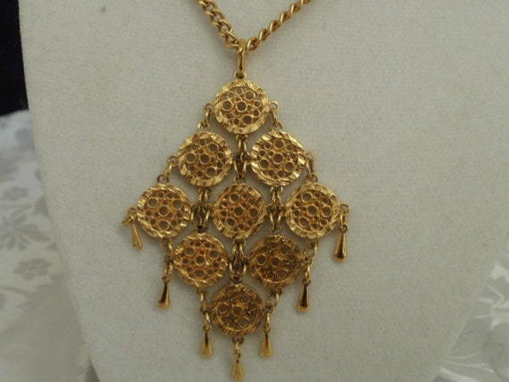 """Vintage D'Orlan pendant, 1970s """"coins and drops""""  articulated pendant, gold tone"""