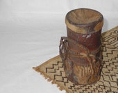 African butter pot made of hand carved wood and leather, unique artifact
