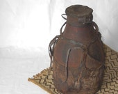 African honey pot made of hand carved wood covered in leather, display artifact