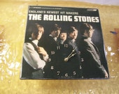 The Rolling Stones England's Newest Hit Makers Album Cover Clock