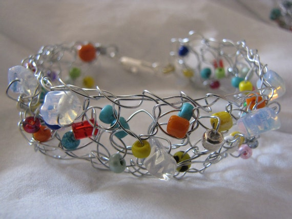 Crocheted wire bracelet multi-colored glass beads and semiprecious stones. Made to order.