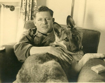 Vintage black and white photograph - Man with german shepherd named Ceasar