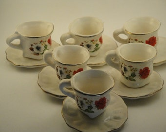 Set of Six Tea Cups and Saucers