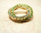 Two. VINTAGE Rhinestone Brooch. Light green and clear stones.