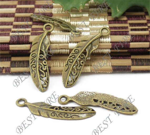 12 pcs of antiqued brass charming totem plume findings pendant 9x38mm