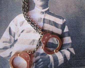 Jailbird Handcuffs Necklace