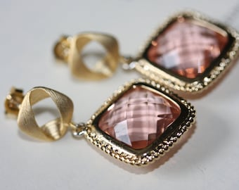 Light paech glass squares dangle from gold post earrings