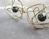 black pearl and gold atomic earrings