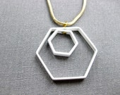 white double hexagon necklace on long gold snake chain
