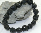 Special offers 12mm Black Skull Turquoise skeleton carved stone beads bracelet  Elastic Cord bangle