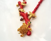 coral red tropical turtle necklace