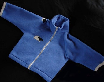 Hotsy Totsy of Vermont fleece jacket in periwinkle blue with darling appliqued sheep. Available in sizes: L, XL