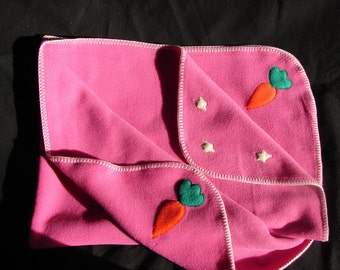Hotsy Totsy of Vermont fleece whip stitched baby blanket in Bubblegum Pink with appliqued Carrots and Stars (all 4 corners are appliqued).