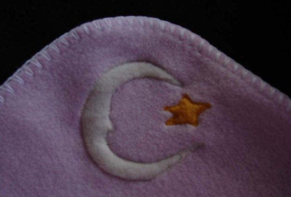 Hotsy Totsy of Vermont fleece whip stitched baby blanket in baby pink with appliqued New Moons and Stars (all 4 corners are appliqued).