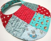 QUILTED BIB red and blue hedgehogs reversible patchwork baby bib