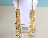 Beth - Gold chain, turquoise, white, clear beads and gold medallions