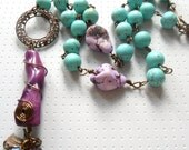 Purple and turquoise necklace in antique brass