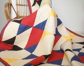 Throw Quilt - Striking design in primary colours with wonderful pebble quilting.