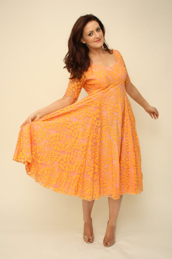 Vintage 1950s orange lace full circle dress