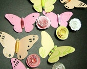 butterflies and spiral rose flowers cut out embellishments with paper bead bodies and stamped flourishes