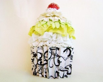 cupcake gift card holder with a cherry on top and black and white swirl paper