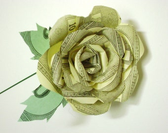 vintage yellow monopoly money paper rose on stem with 2 leaves upcycled