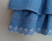 Upcycled denim ruffle skirt with embroidered edge size 5