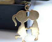 the kissing couple necklace.