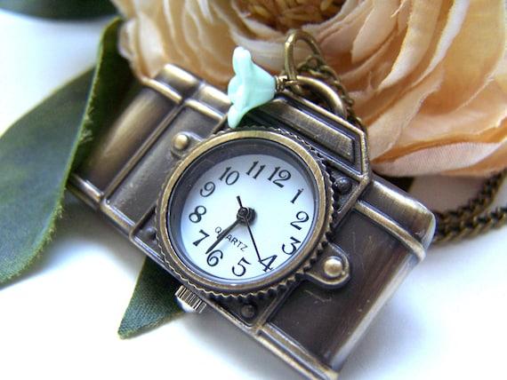 the camera pocket watch (necklace).