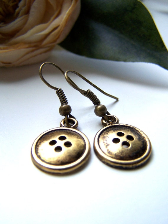 the bronze button earrings.