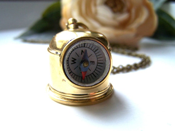 the diver's helmet compass necklace.