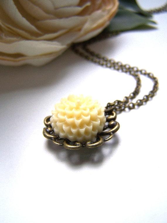 the buttercream pom necklace.