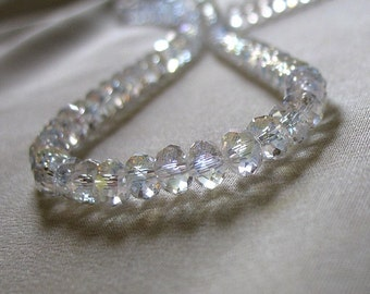 Clear Crystal Rondelle beads with AB finish, 6mm x 4mm, 50 pieces.