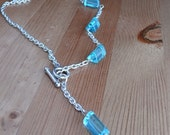 necklace Asymmetric blue glass front toggle closure