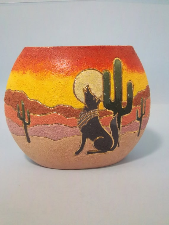 Southwestern Sun Raise Pillow Vase with oranges, yellows and reds in the sky