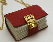 Poppy red leather book necklace with gold clasp