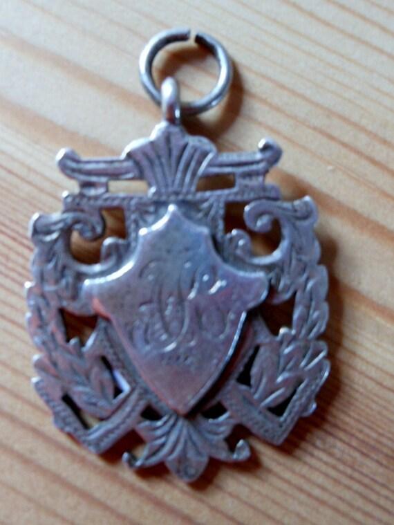 Heavy Pierced Sterling Silver  Fob.c1911