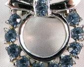 Vintage jewelry brooch in  blue rhinestone circle brooch in high polish silver tone 50s