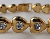 Vintage jewelry bracelet by  Jojak gold tone Austrian Clear Crystal heart bracelet and matching pierced stud earrings