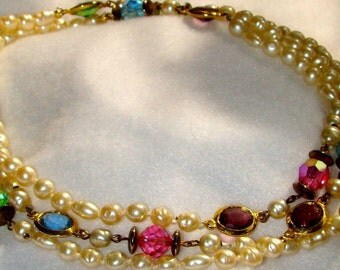 Vintage jewelry necklace in hand knotted vintage ivory fresh water pearls and pink, green, purple, blue crystal beads