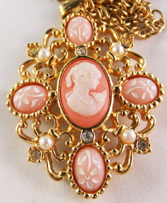 Vintage signed Avon faux pink cameo necklace with simlated pearl and clear rhinestone accents
