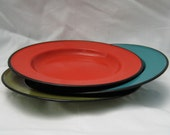 Set of three vintage enamel camp plates. Red Blue and Green