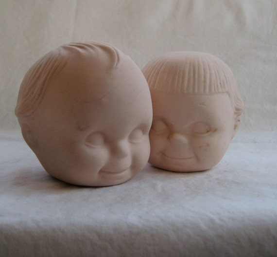 RESERVED -Two Smiling Kewpie Doll Heads