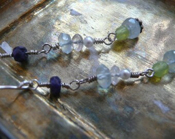 Sapphire, Aqua Marine, Tiny Pearl and Silver wIth a Crystal Bead too... AND Peridot for a Smidge Of Green
