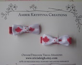 Two Canadian ribbon hair clips